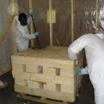 Remediation of refractory brick in containment enclosure