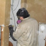 Chicagoland Mold Doctor technician removing mold affected drywall
